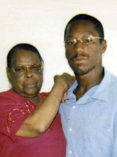 John Edward Smith and grandmother Laura Neal. Smith spent 19 years in jail for a murder he didn't do