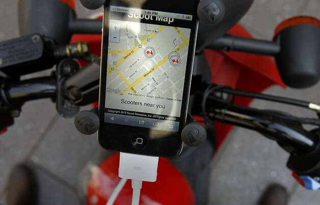 Scoot customers dock their smartphones on their scooter's dash to access pertinent information. Photo: Brant Ward, The Chronicle