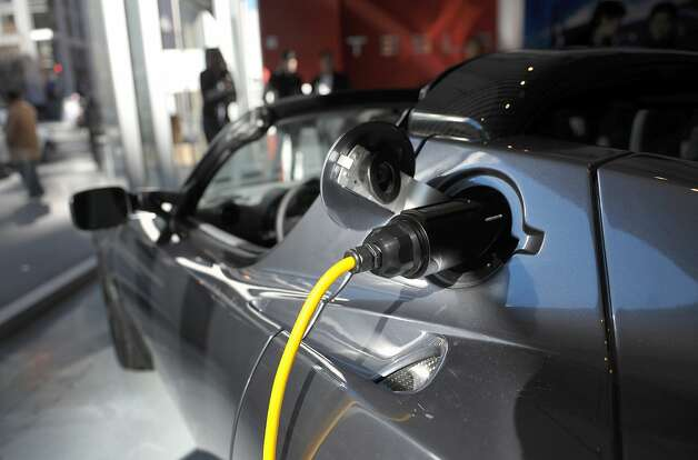 A Tesla Roadster is recharged in 2011. Tesla's new recharging stations are only for most Model S sedans. Photo: Mandel Ngan, AFP/Getty Images