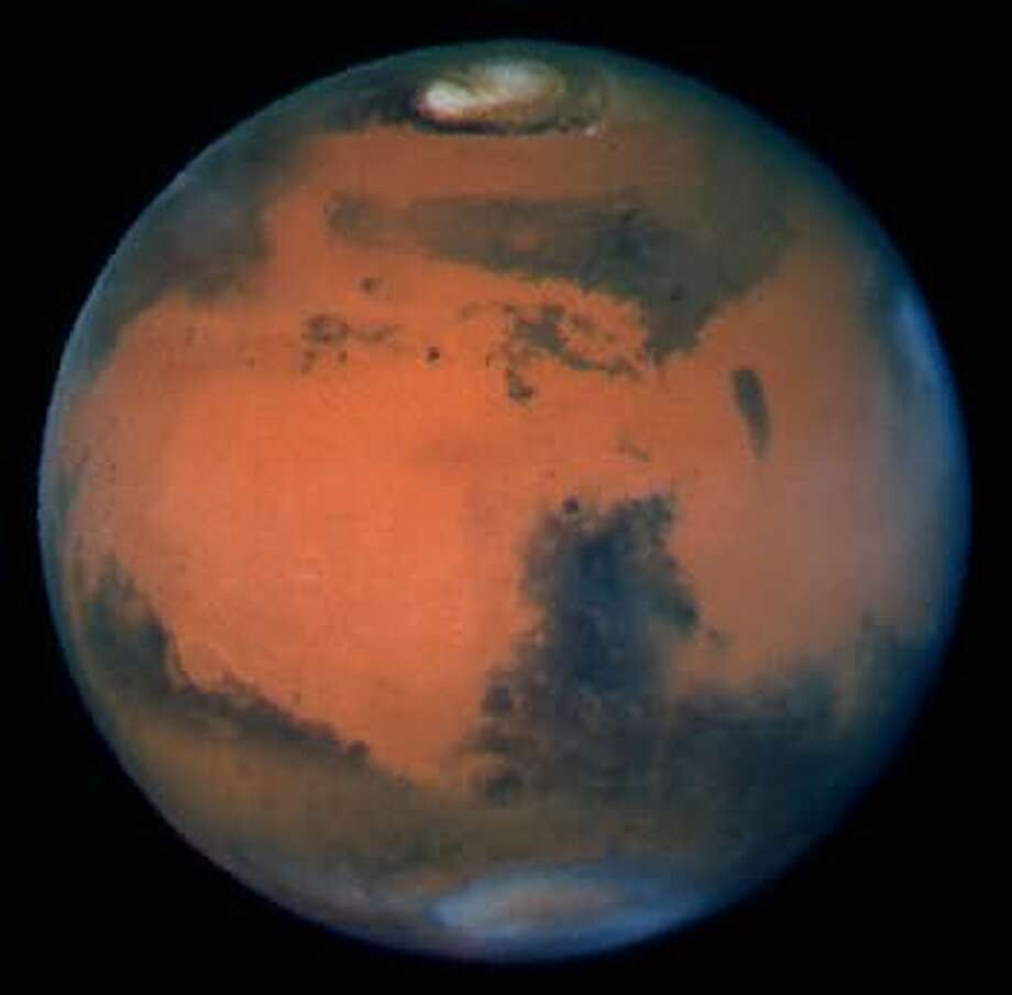 The origin of life on Earth? Mars is shown here in 1997, when it was only about 60 million miles from Earth, a relatively close pass.
