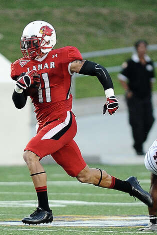 Lamar wide receiver Kevin Johnson charges past Langston at Provost Umphrey Stadium on Saturday, September 22, 2012. Photo taken: Randy Edwards/The Enterprise