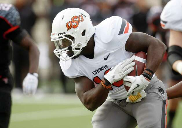 Oklahoma State running back Herschel Sims in an NCAA college football game against Texas Tech in Lubbock, Texas, Saturday, Nov. 12, 2011. (AP Photo/Sue Ogrocki) Photo: AP, STF / AP2011