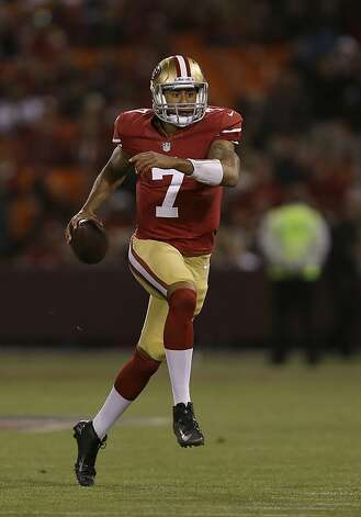 San Francisco 49ers quarterback Colin Kaepernick's 17 yards sprint set up David Akers' record-tying kick. Photo: Marcio Jose Sanchez, Associated Press