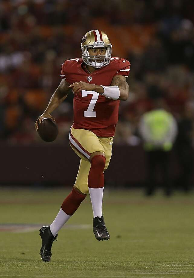 What if Sunday's 49ers-Jets game came down to a duel between Colin Kaepernick (left) and Tim Tebow? Photo: Marcio Jose Sanchez, Associated Press