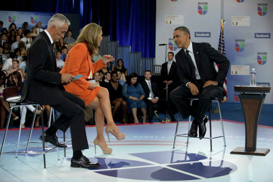 President Barack Obama participates in a town hall hosted by Univision and Univision news anchors Jorge Ramos, left and Maria Elena Salinas. Ruben Navarette says he deflected questions about his broken immigration promise. (AP Photo/Carolyn Kaster) Photo: Carolyn Kaster, Associated Press / AP