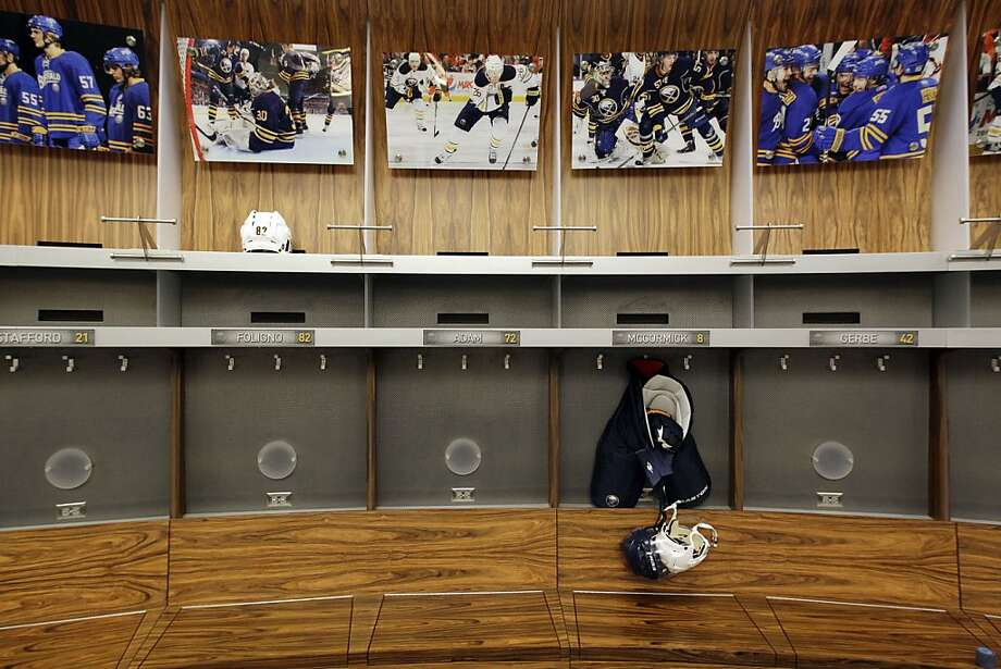 An empty Buffalo Sabres locker room is shown at the First Niagara Center, home of the Buffalo Sabres NHL hockey team, in Buffalo, N.Y., Tuesday, Sept. 25, 2012. The NHL and its union are to return to the bargaining table Friday, the first negotiations since the lockout began Sept. 15. (AP Photo/David Duprey) Photo: David Duprey, Associated Press