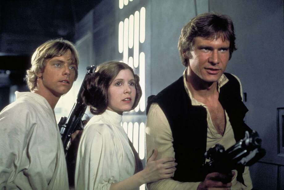 """Released in 1977, """"Star Wars"""" was a cultural phenomenon, turning Mark Hamill (L), Carrie Fisher (center) and Harrison Ford (R) into enormous movie stars.  Photo: Courtesy 20th Century Fox Home Video"""