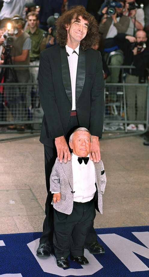 "It may actually surprise some people to know there was a man inside R2's suit. It was  Kenny Baker, shown here with Chewbacca actor Peter Mayhew at the premier of ""Star Wars: Episode 1 -- The Phantom Menace"" at  London's Leicester square on July 14, 1999. Photo: MIKE SIMMONDS/etty Images, AFP/Getty Images"