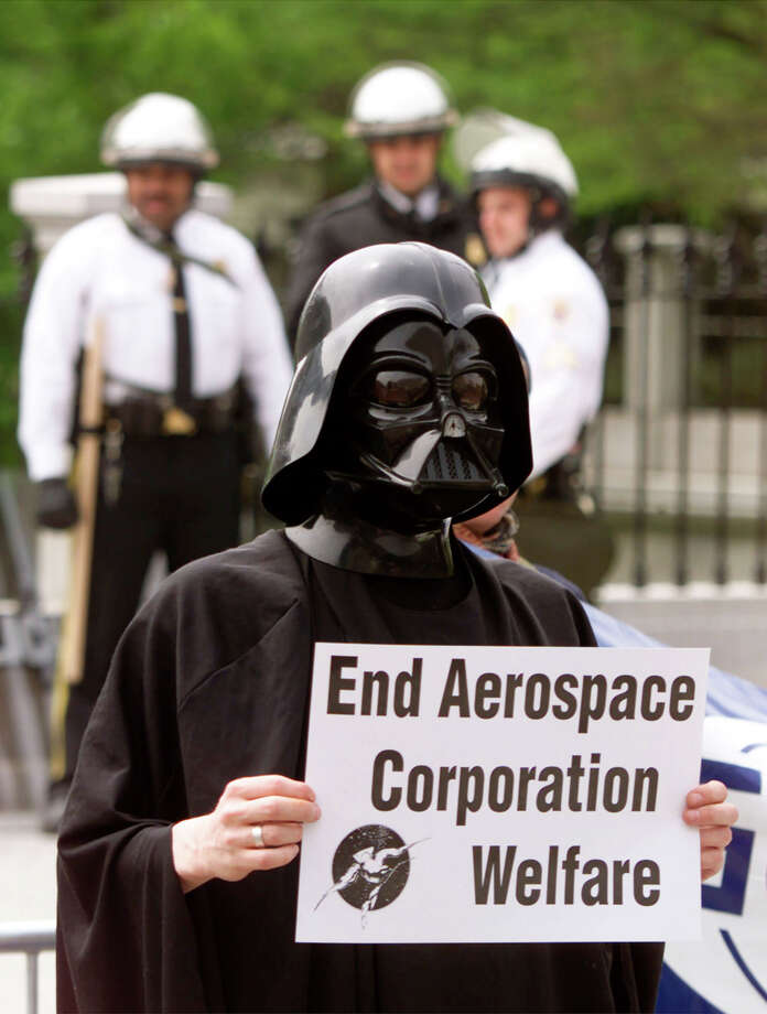 "Even after his ""death"" in ""Return of the Jedi,"" Vader has gotten around. Here, he is on April 14, 2000 in front of the U.S. Treasury Department in Washington D.C. Ironically, he was protesting against using taxpayers dollars to fund a new arms race in space. Photo: Mark Wilson/Getty Images, Getty Images"