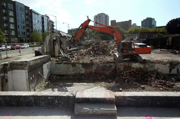 Workers continue to tear down the former Skoochies dance club on Tuesday, September 25, 2012 near Seattle Center. The building holds memories for many young people that grew up in the 90s. Photo: JOSHUA TRUJILLO / SEATTLEPI.COM