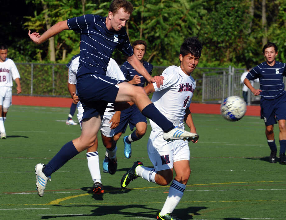 Staples #11 Andrew Travers kicks the team's only goal, during boys soccer action against Brien McMahon in Norwalk, Conn. on Tuesday September 25, 2012. They beat McMahon 1-0. Photo: Christian Abraham / Connecticut Post