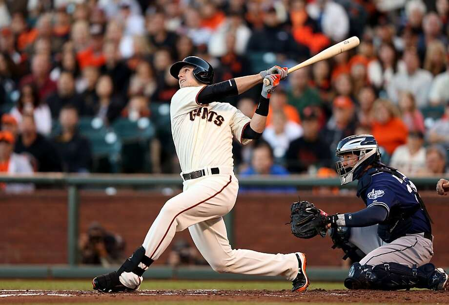 "Giants catcher Buster Posey says that last year's ankle injury would be ""a little bit of a factor"" in whether he'd accept an invitation to play on the U.S. team. Photo: Ezra Shaw, Getty Images"