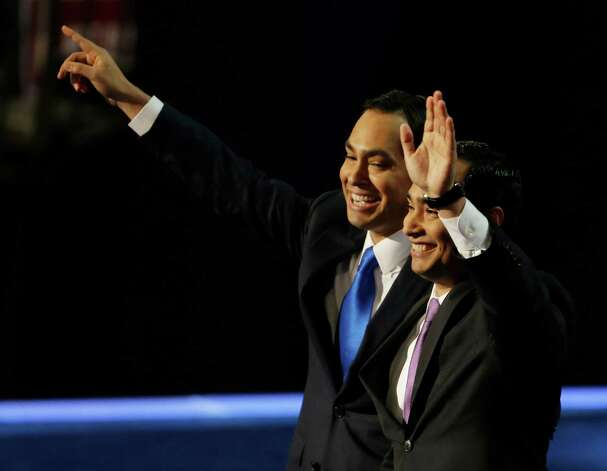 San Antonio Mayor Julian Castro, left, and his brother Joaquin Castro, wave at delegates at the Democratic National Convention in Charlotte, N.C., on Tuesday, Sept. 4, 2012. (AP Photo/Lynne Sladky) Photo: Lynne Sladky, Associated Press / AP