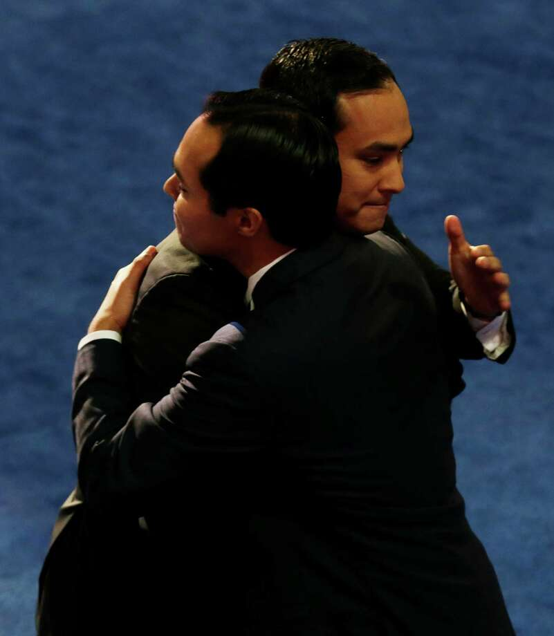 San Antonio Mayor Julian Castro, left, hugs his brother Joaquin Castro, at the Democratic National Convention in Charlotte, N.C., on Tuesday, Sept. 4, 2012. (AP Photo/Charlie Neibergall) Photo: Charlie Neibergall, Associated Press / AP