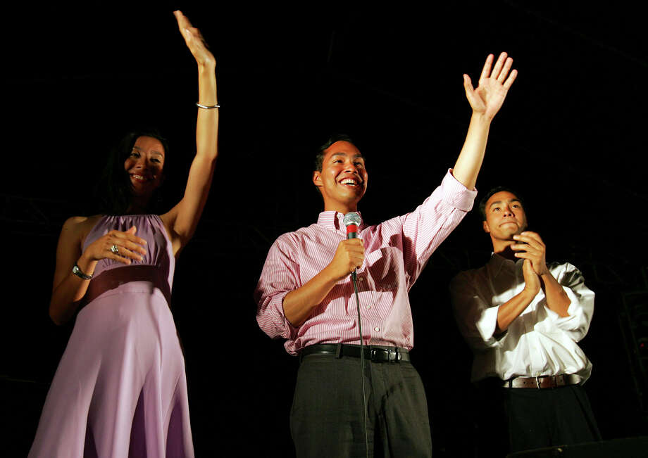 Councilman Julian Castro, center, candidate for San Antonio mayor, addresses the crowd Tuesday, June 7, 2005, in San Antonio at Castro's campaign headquarters. At left is his girlfriend, Erica Lira, and at right is his twin brother, Joaquin. Retired state judge Phil Hardberger held a narrow lead over Castro late Tuesday in the mayoral runoff. Photo: BAHRAM MARK SOBHANI, AP / SAN ANTONIO EXPRESS-NEWS