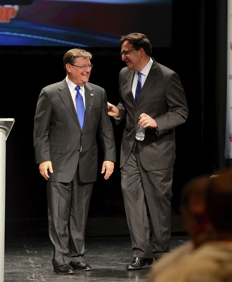 "Congressman Francisco ""Quico"" Canseco (left) and  State Representative Pete Gallego (Right) have a laugh on stage at the conclusion of a Spanish-language debate between Congressman Francisco ""Quico"" Canseco (R-San Antonio) and State Representative Pete Gallego (D-Alpine) on Tuesday, September 25, 2012 at Palo Alto College in San Antonio Texas. John Albright / Special to the Express-News. Photo: JOHN ALBRIGHT, For The Express-News / San Antonio Express-News"