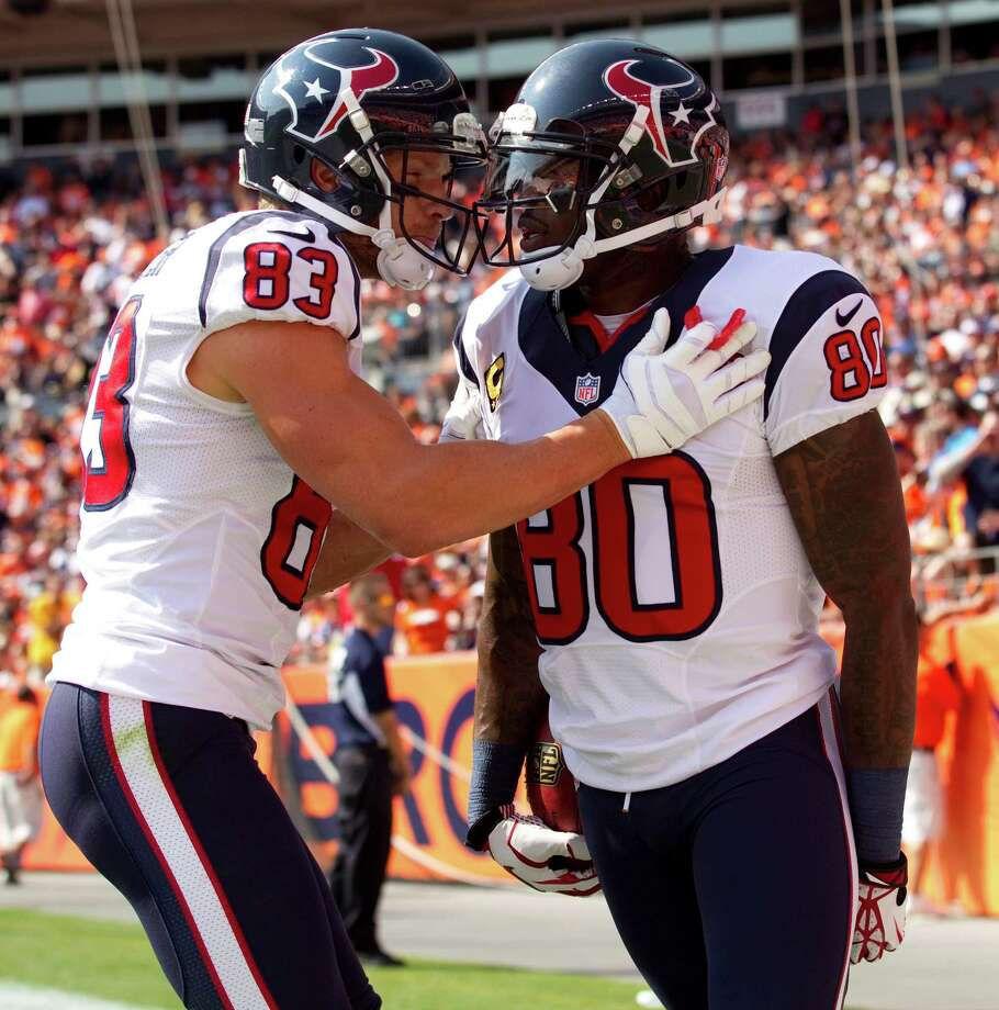 Texans wide receivers Kevin Walter (left) and Andre Johnson celebrate Johnson's 60-yard touchdown reception against the Broncos on Sunday. Photo: Brett Coomer, Houston Chronicle / © 2012  Houston Chronicle