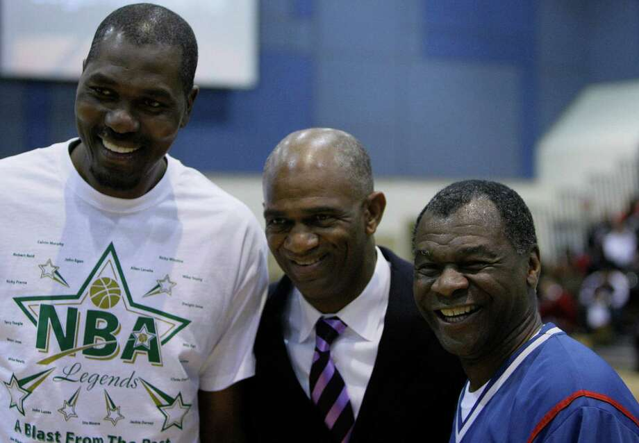 Hakeen Olajuwon ,left,  Pastor Kirbyjon Caldwell of Windsor Village United Methodist Church Houston, center, and Calvin Murphy, right, pose for photographs before the Legends all-star basketball game against the Leader's Academy at Windsor United Methodist Church Friday, Jan. 25, 2008, in Houston.  ( Melissa Phillip / Chronicle ) For Photo: Melissa Phillip / Houston Chronicle