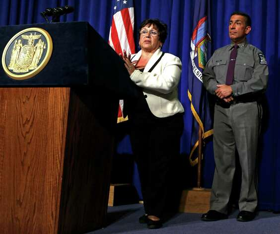 New York State Department of Motor Vehicles Commissioner Barbara Fiala, left, and New York State Police Superintendent Joseph D'Amico, speak about new regulations for repeat drunken and drugged drivers during a news conference at the Capitol on Tuesday, Sept. 25, 2012, in Albany, N.Y. Under regulations issued Tuesday, the Department of Motor Vehicles is to review the lifetime records of drivers seeking reinstatement after a revocation and deny any that have five or more alcohol- or drug-related driving convictions. The DMV is also supposed to deny relicensing for those with three or more such convictions and at least one serious driving offense within the last 25 years. The agency says drunken drivers whose licenses have been revoked or suspended for six months will no longer be able to get privileges back in seven weeks by completing a program. (AP Photo/Mike Groll) Photo: Mike Groll