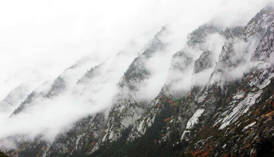 Clouds blanket Little Cottonwood Canyon in the snow and rain Tuesday, Sept. 25, 2012, near Sandy, Ut