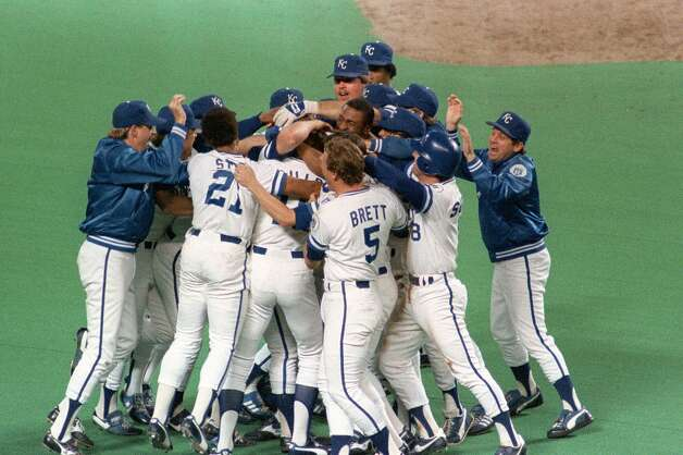 The Kansas City Royals celebrate their 1985 World Series triumph over the St. Louis Cardinals in seven games, converging on the pitchers mound. In the ninth inning of Game 6 with the Cardinals close to wrapping up the title, Kansas City's Jorge Orta grounded a ball to first base. St. Louis pitcher Todd Worrell ran to cover first and appeared to have beaten Orta to the base. But first-base umpire Don Denkinger ruled Orta safe, setting up a two-run rally that powered the Royals to a 2-1 victory, a Game 7 win and the title. Photo: Associated Press File Photo