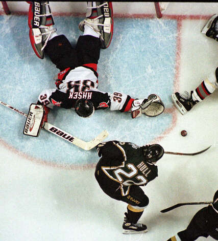 With one skate in the crease, Dallas Stars right wing Brett Hull (22) shoots the Stanley Cup winning goal past the sprawling Buffalo Sabres goalie Dominik Hasek (39) in the third overtime period of Game 6 of the Stanley Cup Finals in Buffalo, N.Y., early Sunday morning, June 20, 1999. Photo: Gene Puskar, Associated Press File Photo / AP