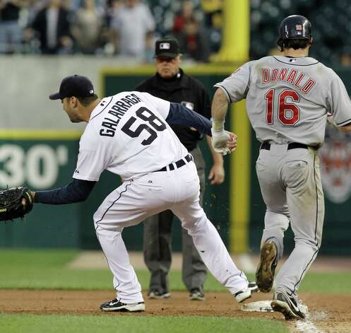 Detroit Tigers pitcher Armando Galarraga (58) covers first base as Cleveland Indians' Jason Donald, right, runs to the base and umpire Jim Joyce looks on in the ninth inning of a baseball game in Detroit Wednesday, June 2, 2010. Joyce called Donald safe and Galarraga lost his bid for a perfect game with two outs in the ninth inning on the disputed call at first base. Detroit won 3-0. Photo: Paul Sancya, Associated Press File Photo / AP