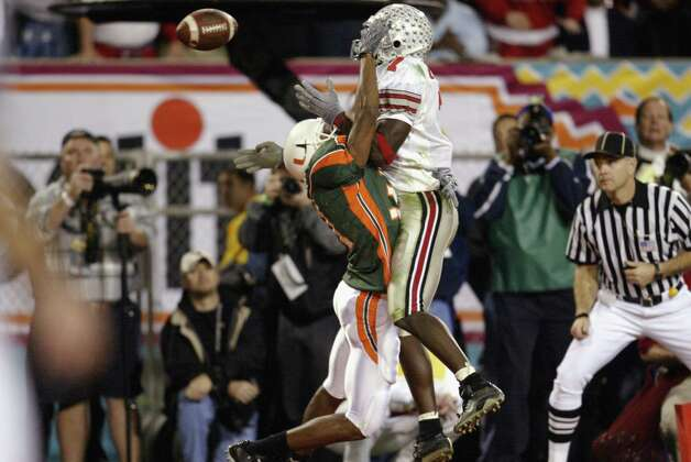 Defensive back Glenn Sharpe #31 of the Miami Hurricanes is called for pass-interference on split end Chris Gamble #7 of the Ohio State Buckeyes. Ohio State scored a tying touchdown later in the possession. The Buckeyes claimed the title after they scored and Miami was stopped on the game's final possession, denying the Hurricanes back-to-back BCS championships. Photo: Brian Bahr, Getty Images File Photo / 2003 Getty Images