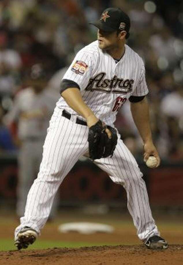Xavier Cedeno prepares to wind up. (Melissa Phillip / © 2012 Houston Chronicle)