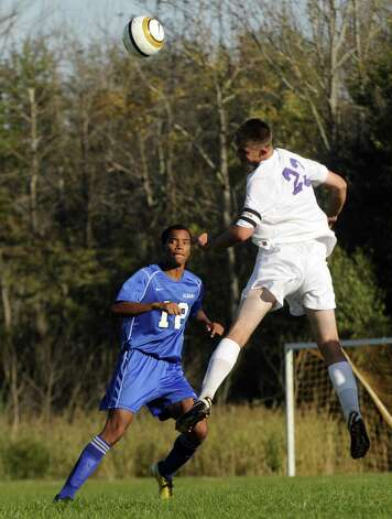 CBA's Brandon Bolger, left , heads the ball defended by Albany's Khalid Holtzclaw during the Albany at CBA boys' varsity soccer game in Colonie, NY Tuesday Sept. 25, 2012. (Michael P. Farrell/Times Union) Photo: Michael P. Farrell