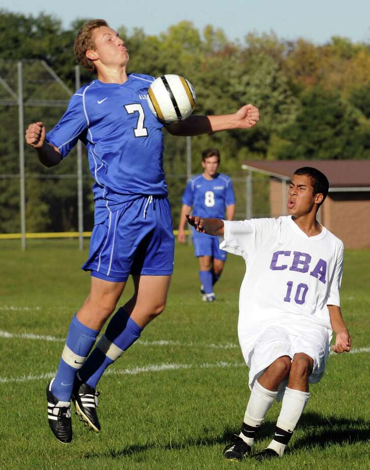 Albany's Jonno Hillengas, left, and CBA's Michael Wasilchuk battle for the ball during the Albany at CBA boys' varsity soccer game in Colonie, NY Tuesday Sept. 25, 2012. (Michael P. Farrell/Times Union) Photo: Michael P. Farrell