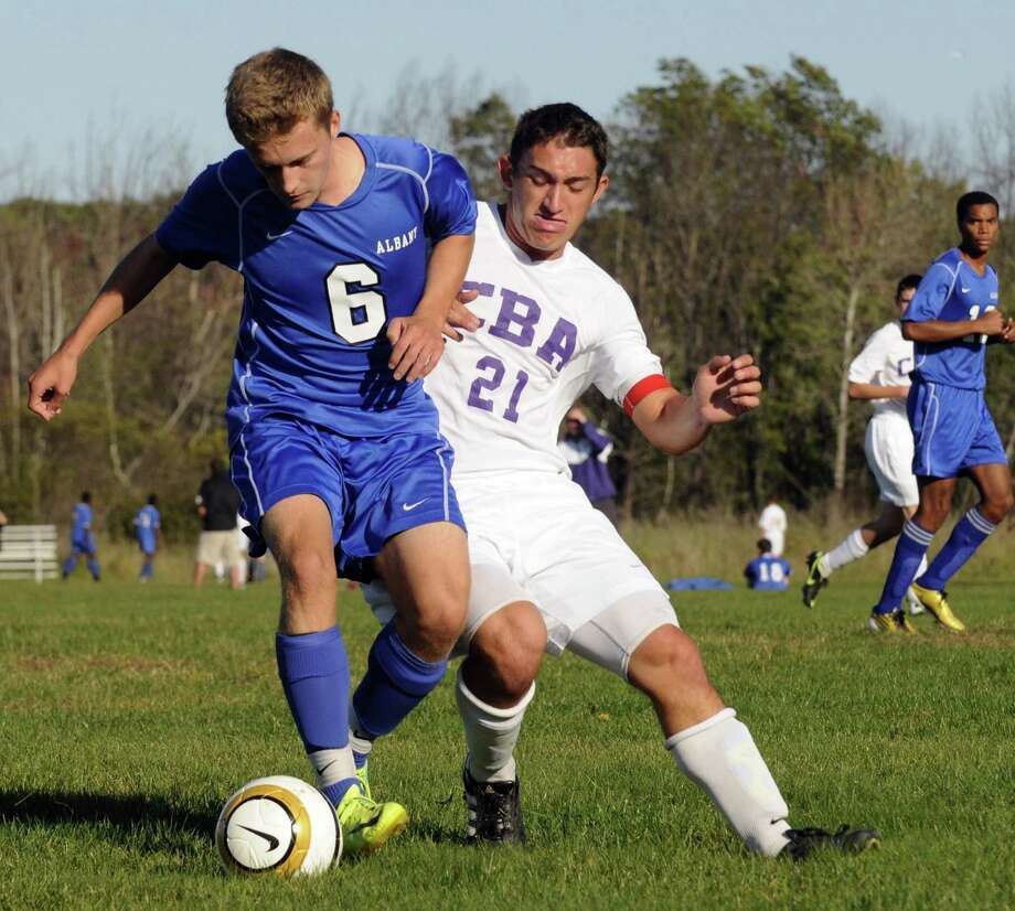 Albany's Denis Leon, left, and CBA's Thomas Steffens battle for the ball during the Albany at CBA boys' varsity soccer game in Colonie, NY Tuesday Sept. 25, 2012. (Michael P. Farrell/Times Union) Photo: Michael P. Farrell
