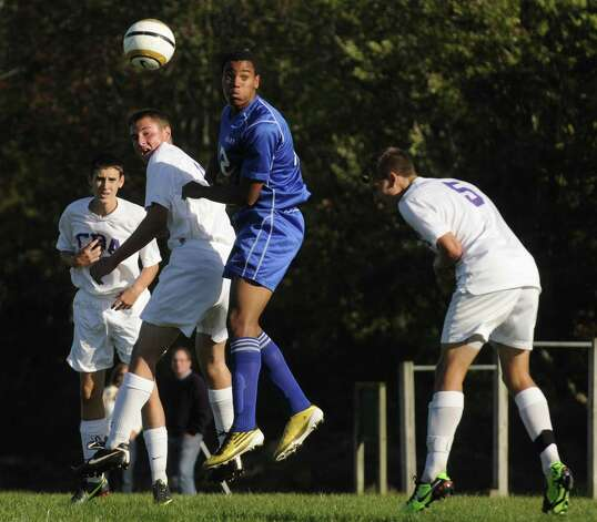 CBA's Ethan Nadel, right, heads the ball during the Albany at CBA boys' varsity soccer game in Colonie, NY Tuesday Sept. 25, 2012. (Michael P. Farrell/Times Union) Photo: Michael P. Farrell