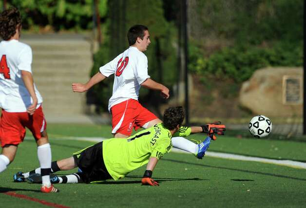 Fairfield Prep's Davie Bruton kicks the ball past West Haven goalkeeper Danny Pendergast during their soccer match Tuesday, Sept. 25, 2012 at Fairfield Prep. Photo: Autumn Driscoll / Connecticut Post