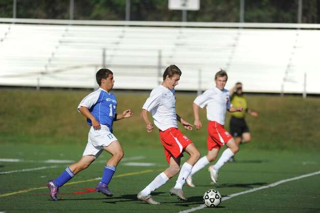 Fairfield Prep's Grayson Barlow drives the ball down the field on his way to a goal as West Haven's Frederico Dasilva defends during their soccer match Tuesday, Sept. 25, 2012 at Fairfield Prep. Photo: Autumn Driscoll / Connecticut Post