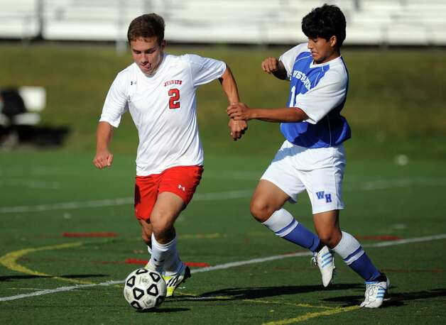 Fairfield Prep's Ryan Orvis controls the ball as West Haven's Pablo Perez defends during their soccer match Tuesday, Sept. 25, 2012 at Fairfield Prep. Photo: Autumn Driscoll / Connecticut Post