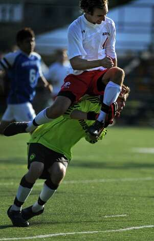 Fairfield Prep's Dave Bigley collides with West Haven goalkeeper Danny Pendergast after scoring during their soccer match Tuesday, Sept. 25, 2012 at Fairfield Prep. Photo: Autumn Driscoll / Connecticut Post