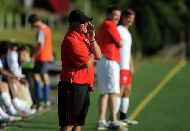 Fairfield Prep boys soccer coach Ryan Lyddy talks to a player during their soccer match versus West Haven Tuesday, Sept. 25, 2012 in Fairfield, Conn. Photo: Autumn Driscoll / Connecticut Post