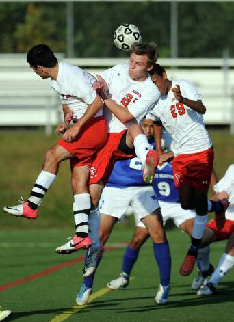 Fairfield Prep's Bryce Keblish, center, goes up for a header during game action against West Haven Tuesday, Sept. 25, 2012 at Fairfield Prep. Photo: Autumn Driscoll / Connecticut Post