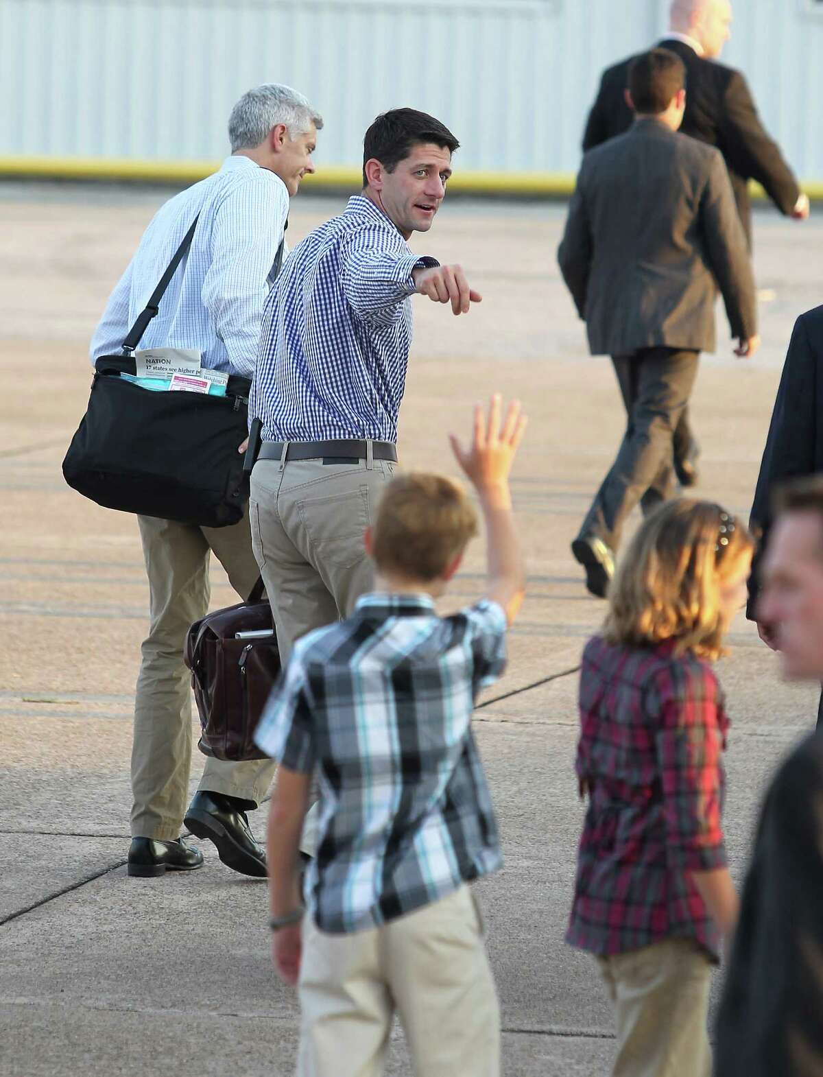 Carson King, 12, and his sister Courtney, 11, greet Paul Ryan as he arrives Tuesday at Hobby Airport's Wilson Air Center.