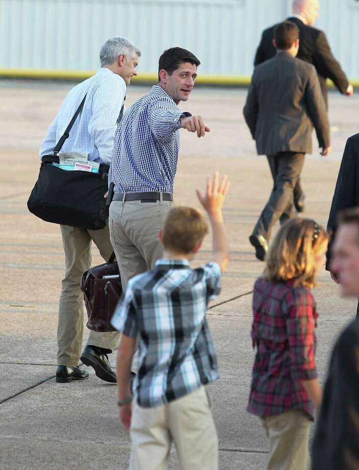 Carson King, 12, and his sister Courtney, 11, greet Paul Ryan as he arrives on Tuesday at Hobby Airport's Wilson Air Center. Photo: Karen Warren / © 2012  Houston Chronicle