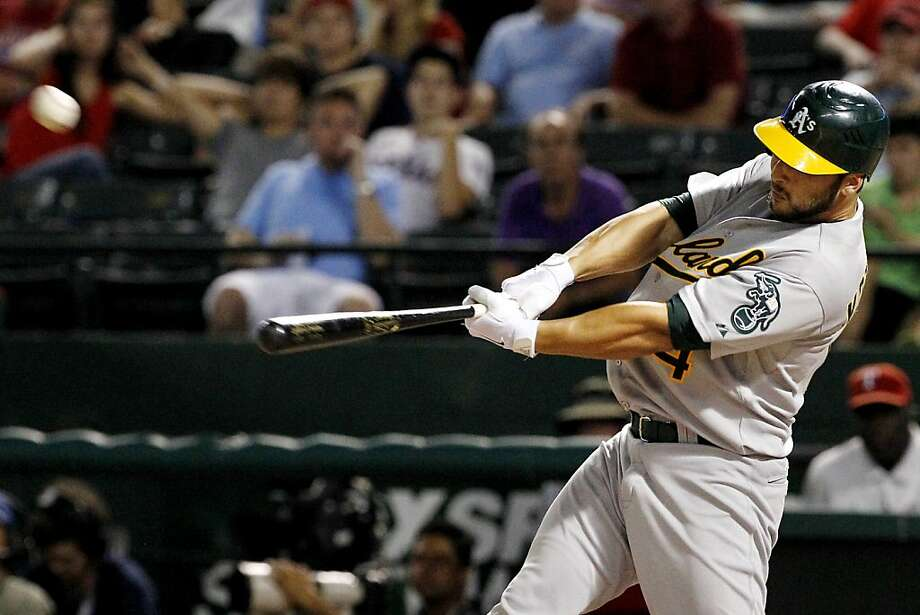 Oakland Athletics' George Kottaras (14) connects for a solo home run off of Texas Rangers' Mark Lowe in the 10th inning of a baseball game, Tuesday, Sept. 25, 2012, in Arlington, Texas. The Athletics won 3-2. (AP Photo/Tony Gutierrez) Photo: Tony Gutierrez, Associated Press