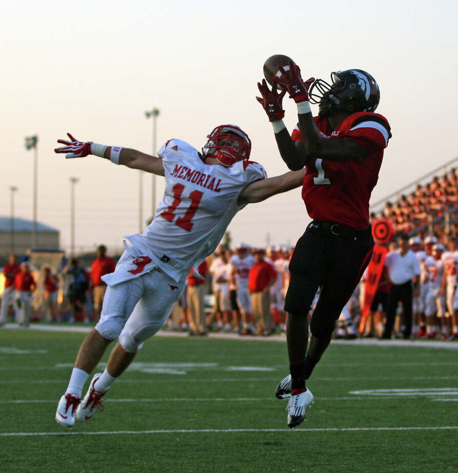 Westfield's Tevin Lewis (right) hauls in a 37-yard touchdown reception over Memorial's David Holland during the first half of a high school football game on September 7, 2012. Photo: Eric Christian Smith