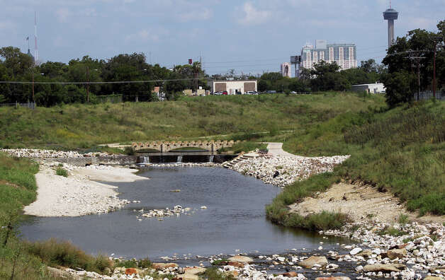 Members of the San Antonio Hotel and Lodging Association saw views such as this of the Mission Reach portion of the San Antonio River at East Theo Avenue and other Mission Reach areas Tuesday, Sept. 25, 2012, during a bus tour to see how hotel occupancy taxes have been used on renovation and development projects in the area. Photo: JOHN DAVENPORT, San Antonio Express-News / San Antonio Express-News