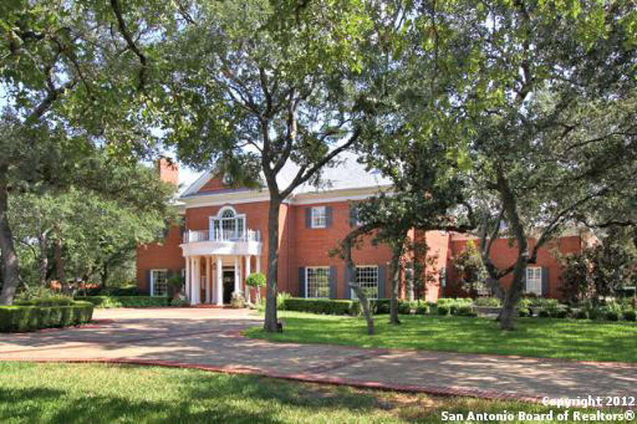 Majestic oaks line the property and the landscaping throughout is meticulously maintained.