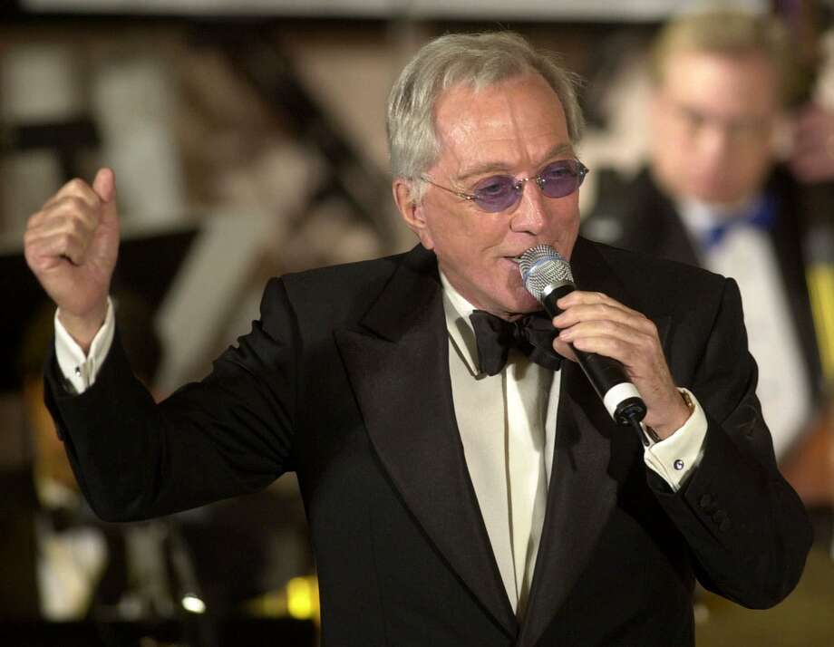 "**FILE**Singer Andy Williams performs July 22, 2001, in Beverly Hills, Calif.  Williams has postponed a tour of Hong Kong, Japan, Thailand and Singapore because of worries over the spread of bird flu in Asia, his Singaporean concert organizer said Thursday, Jan. 29 2004.   Williams, 76, decided to reschedule ""because of his age and health issues,'' said Aris Liu.  The Singapore concert, originally planned for March 6, will take place in July, Liu said. The dates for the other concerts were not immediately available. (AP Photo/John Hayes,file)  HOUCHRON CAPTION (03/09/2004):  Williams. Photo: JOHN HAYES, AP / AP"