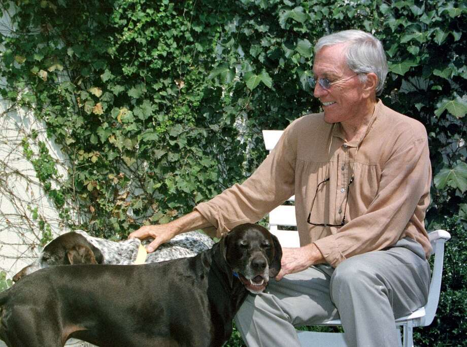 ADVANCE FOR WEEKEND, SEPT. 2-3--Andy Williams spends a  little time with his dogs at his theatre in Branson, Mo., Friday, Aug. 25, 2000. Williams is returning to the stage after nearly a year's rest following problems with his voice. Photo: JOHN S. STEWART, AP / AP