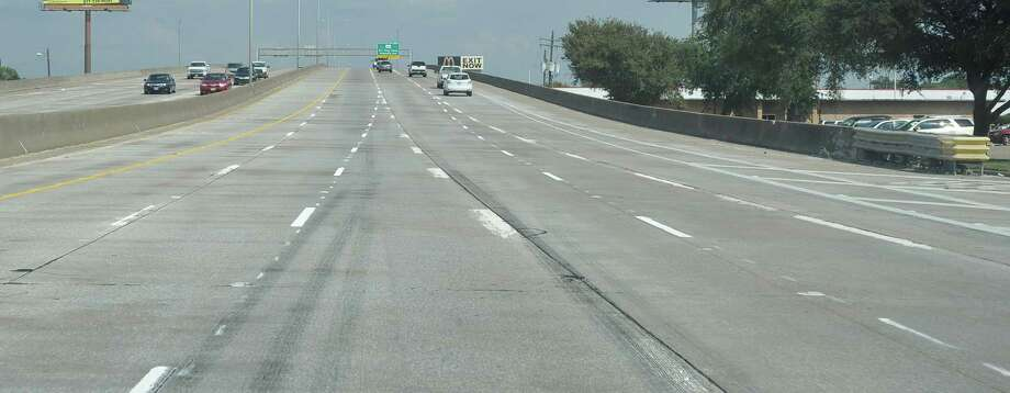 New lane striping on Interstate 10 before the MLK exit, east bound, can be confusing to drivers. Skid marks can be seen on the several sets of line just past the on ramp between 11th Street and 7th Street. The set of lines on the right seem to be guiding motorists where they might not want to go if they are not planning to exit.  Dave Ryan/The Enterprise Photo: Dave Ryan