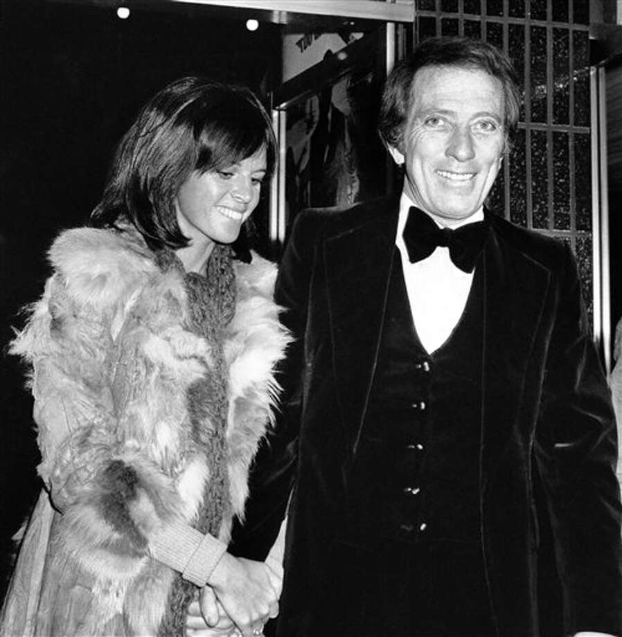 "FILE - In a Dec. 19, 1974  file photo, American singer Andy Williams and his wife Claudine Longet,  shown upon arrival at the Odeon, Leicester Square, London, for the Royal  Charity World premiere of ""The Man With the Golden Gun."" Emmy-winning  TV host and ""Moon River"" crooner Williams died Tuesday night, Sept, 25,  2012 at his home in Branson, Mo., following a year-long battle with  bladder cancer. He was 84. (AP Photo/Press Association, File)"