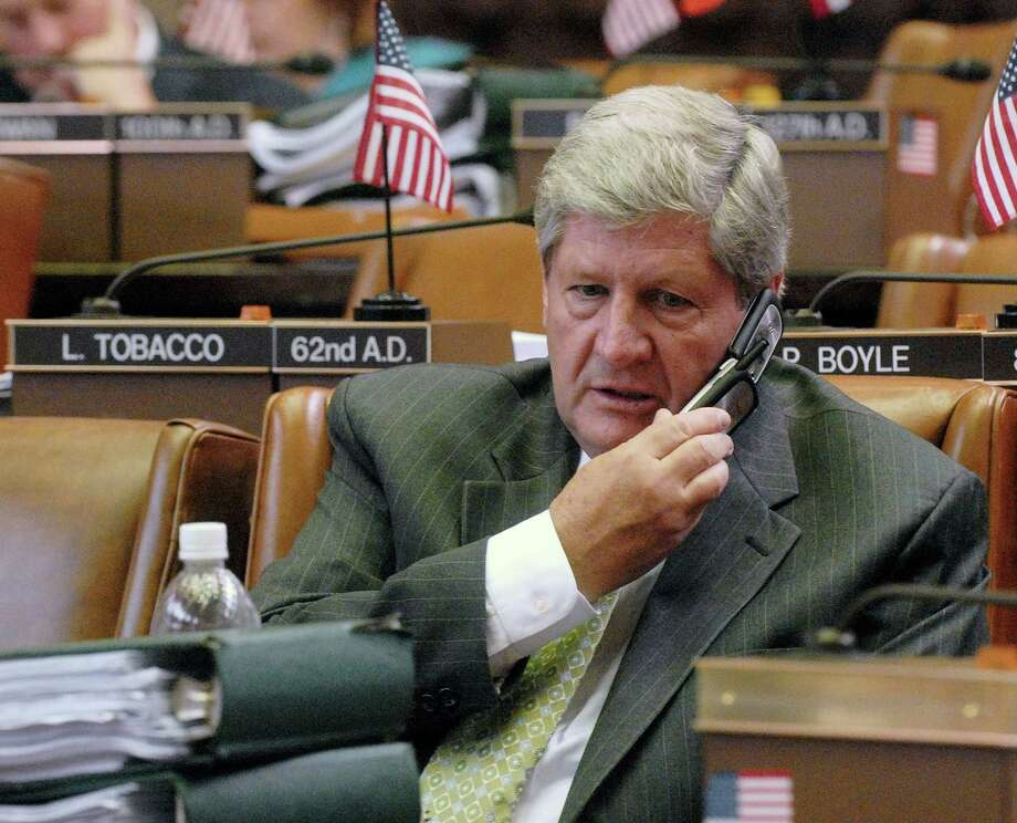 "FILE - In this June 24, 2008 file photo, then-Assemblyman Roy McDonald talks on the phone during a legislative session break at the state Capitol in Albany, N.Y.  Now a state senator, McDonald, who voted to legalize gay marriage in New York and shot back at conservative critics that they could ""take this job and shove it,"" has apparently lost his primary. (AP Photo/Hans Pennink, File) Photo: Hans Pennink"